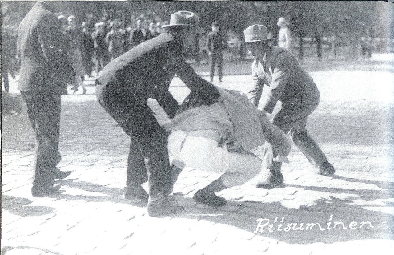 Member of Lapua Movement assault an opponent in front of courthouse in Vaasa June 1930
